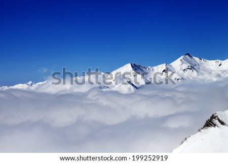Mountains in clouds at nice day. Caucasus Mountains, Georgia, Gudauri. View from ski slope. - stock photo