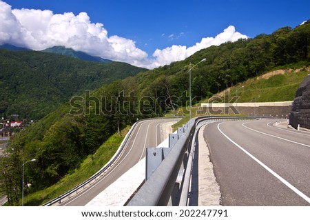 Mountains in clouds, winding road