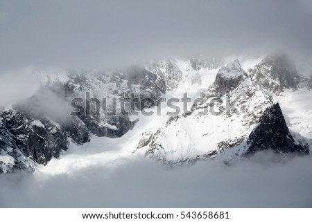 Mountains in cloudy weather. Alps in a fog