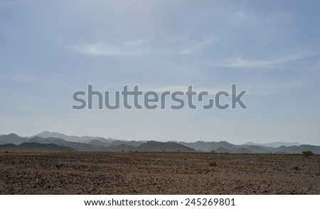 Mountains in gravel desert, Oman - stock photo
