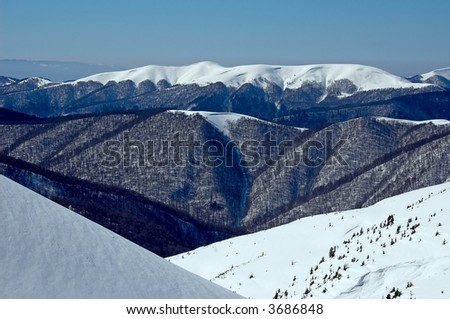 mountains in snow - stock photo