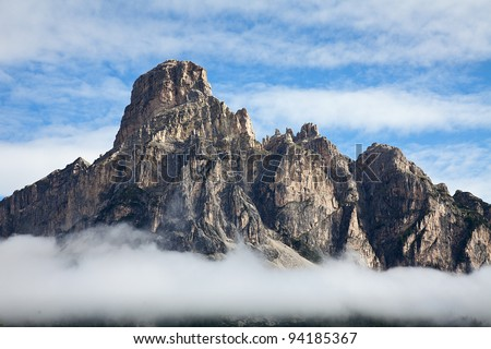 Mountains in the alps with clouds - stock photo