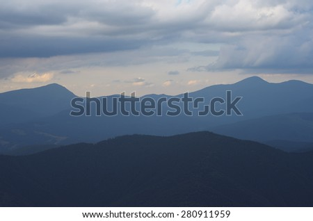Mountains in the clouds. Morning landscape - stock photo