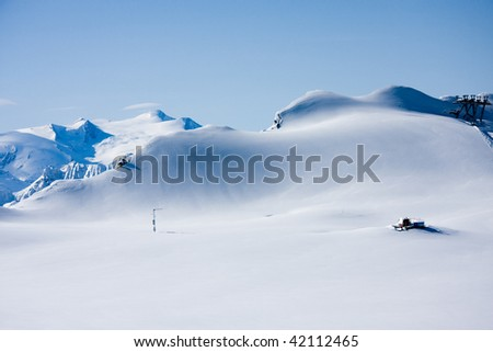Mountains in winter and snowcat fully covered by snow - stock photo
