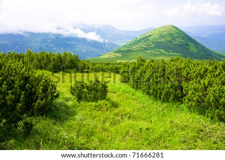 Mountains landscape with clouds and blue sky - stock photo
