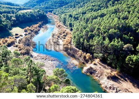 Mountains landscape with river. Guadalquivir river - stock photo