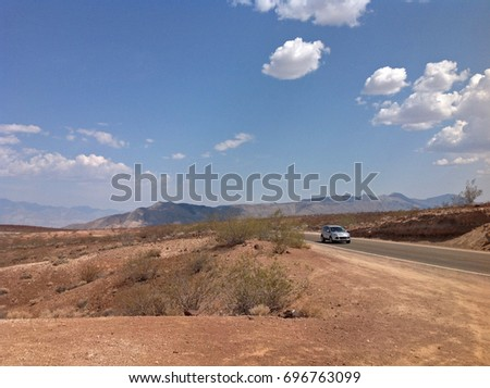 mountains landscape with the car on the scenic road