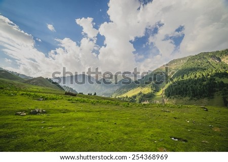 Mountains meadows surrounded with sky and cloud - stock photo