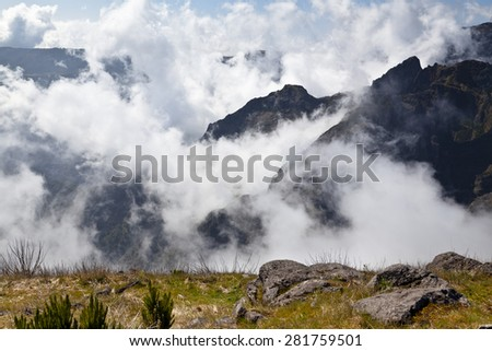 Mountains of Madeira island above the clouds at Pico  Ruivo - stock photo
