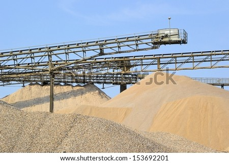 Mountains of sand and gravel in a gravel pit - stock photo