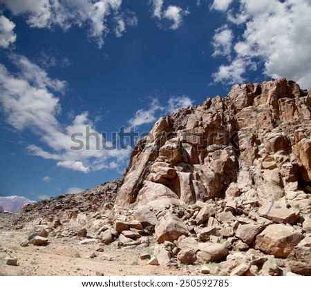 Mountains of Wadi Rum Desert also known as The Valley of the Moon is a valley cut into the sandstone and granite rock in southern Jordan 60 km to the east of Aqaba - stock photo
