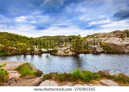Mountains on the way to the Cliff Preikestolen in fjord Lysefjord - Norway - nature and travel background - stock photo
