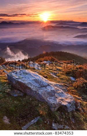 Mountains over the fog in the winter sunrise, Bizkaia, Spain - stock photo