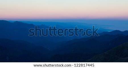 Mountains range at sunrise - stock photo
