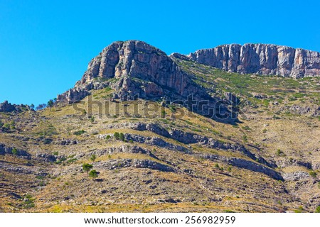 Mountains range in Valencia region, Spain. Stone mountains against a clear blue sky. - stock photo