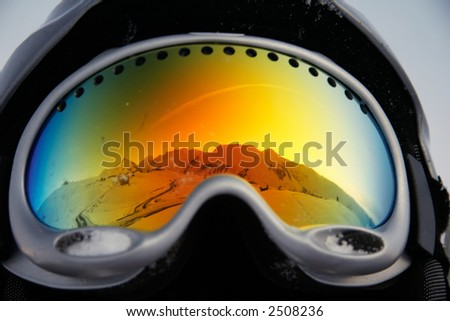 mountains reflected in glasses - stock photo