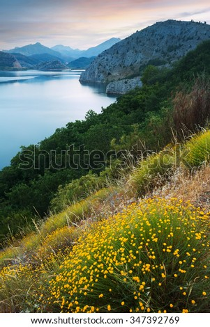 mountains reservoir  in summer twilight - stock photo
