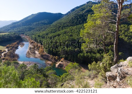 Mountains river with forest riverside. Guadalquivir river, Andalusia  - stock photo