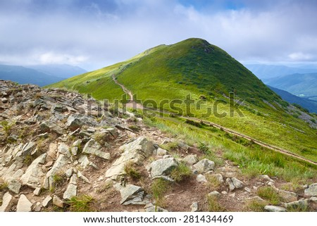 Mountains scenery. Trail to the Tarnica Peak (1346 m). Mountain landscape. Rocks stones grass in The Bieszczady National Park. Carpathians, Poland. - stock photo