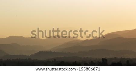 Mountains silhouette, morning - stock photo