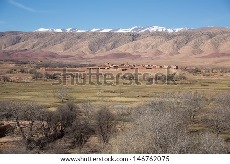 mountains, snow and desert in Moroccan Atlas - stock photo