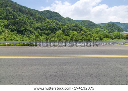Mountains straight road - stock photo
