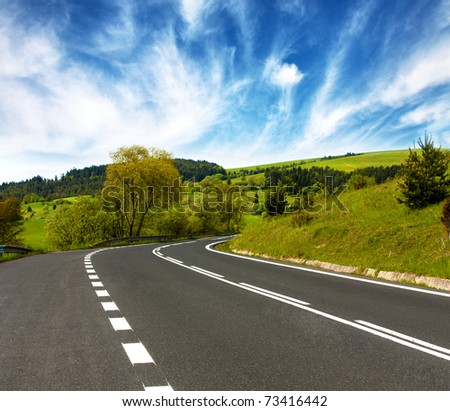 Mountains travel.Empty Curved road - stock photo