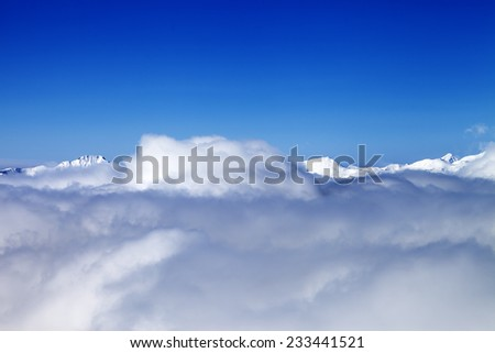 Mountains under clouds in nice day. Caucasus Mountains, Georgia, Gudauri. View from ski slope. - stock photo