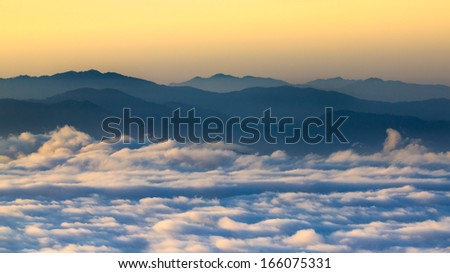 mountains under mist in the morning Doi Phu Kha National Park in Nan ,Thailand