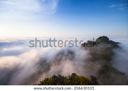 mountains under mist in the morning in Lampang ,Thailand - stock photo