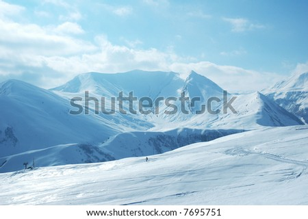 Mountains under the snow on a winter day - stock photo