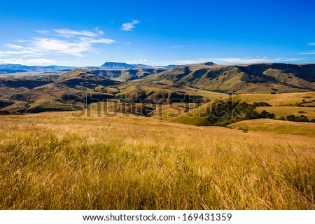 Mountains Valleys Landscape Blue Overlooking the valleys and mountains terrain vegetation landscape late afternoon colors. - stock photo