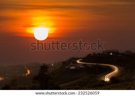 mountains view under mist and curve road in the sunrise ,Phetchabun, Thailand  - stock photo