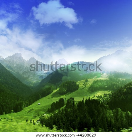 Mountains with green forest landscape. - stock photo