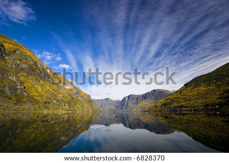 Mountains with reflexion in the water - Fjord in Flam/Norway - stock photo