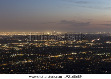 Mountaintop view of Pasadena and Los Angeles at dusk. - stock photo