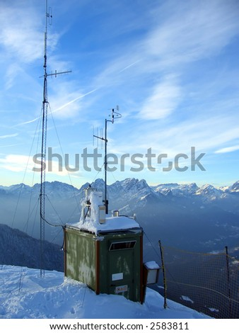 Mountaintop weather station in winter, Alps, Italy