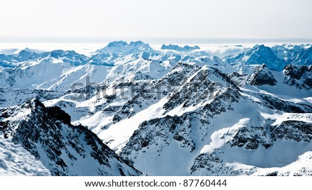 mountaintops in winter, Alps - stock photo