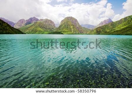 Mountanious lake with moraine water - stock photo