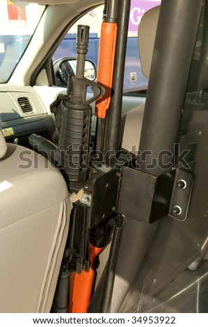 Mounted rifle inside police car.