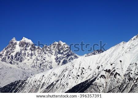 Mounts Ushba and Chatyn and blue clear sky. Caucasus Mountains. Svaneti region of Georgia. - stock photo
