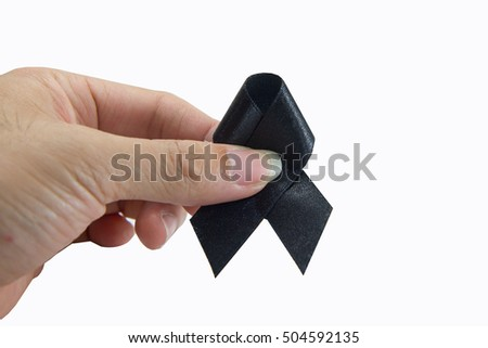 Mourn ribbon in hand