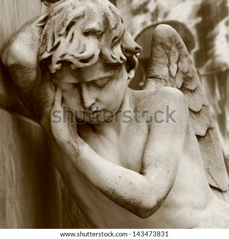 Mourning angel on Recoleta cemetery in Buenos Aires. - stock photo