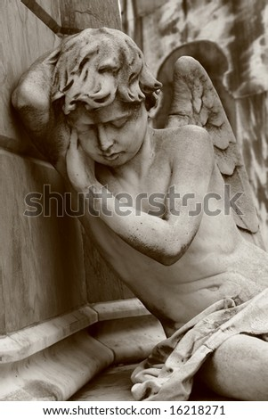 Mourning angel on Recoleta cemetery in Buenos Aires - stock photo