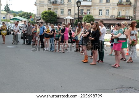 Mourning people in front of the Netherlands Embassy in Kiev 18.07.2014