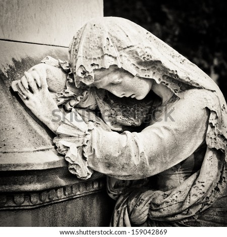 Mourning statue. Cimitero Monumentale, Milan - stock photo
