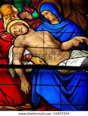 Mourning window in Dom of Cologne, Germany. This stained glass window shows the mourning of the dead Christ who rests in the lap of his mother. It was made in 1847. - stock photo