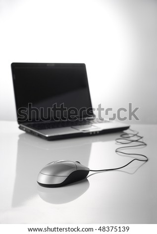 mouse and laptop.focus on foreground