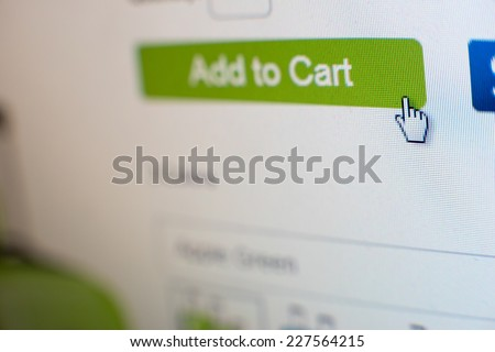 "Mouse Clicking ""add to cart"" button for internet shopping in an e-commerce website - stock photo"