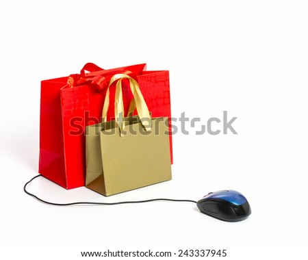 Mouse connected to shopping bags. Online shopping concept - stock photo